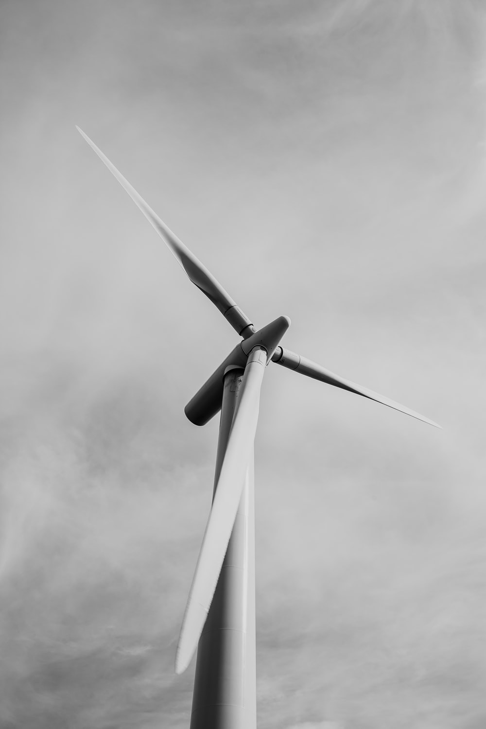 low-angle grayscale photography of a windmill