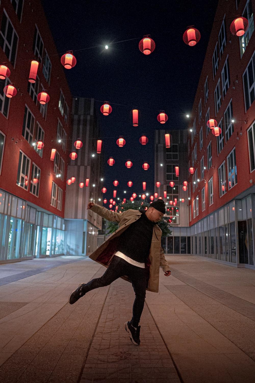 man wearing brown coat during nighttime