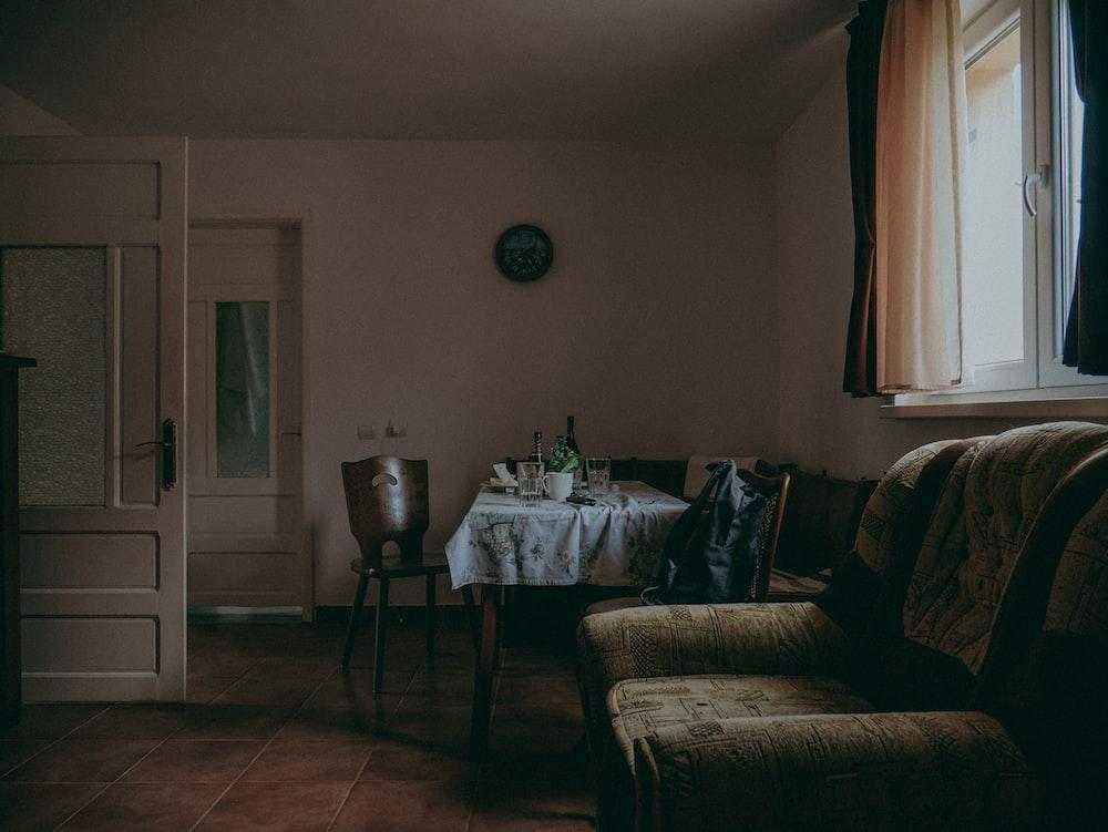 brown fabric sofa inside room