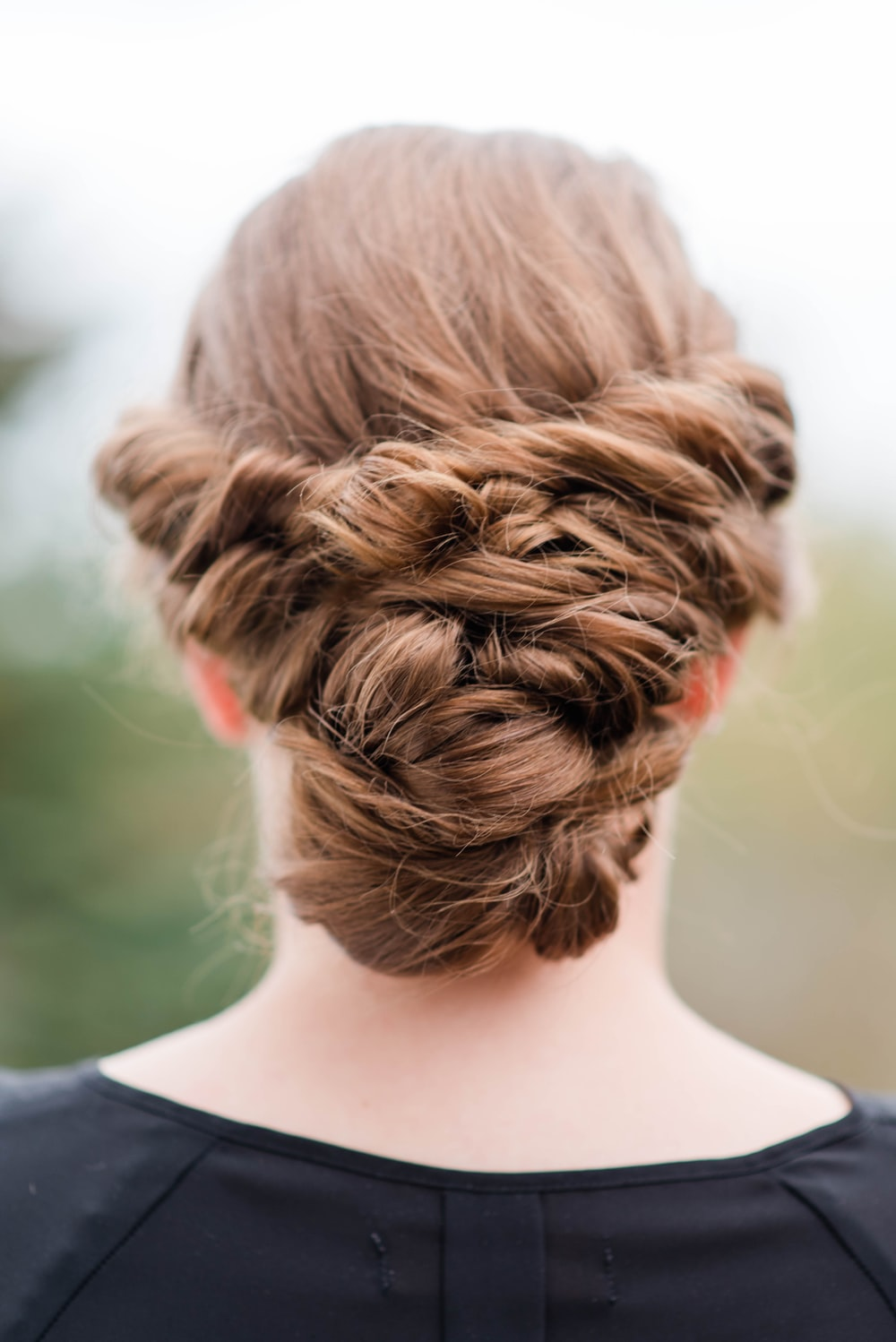 woman with tied brunette hair