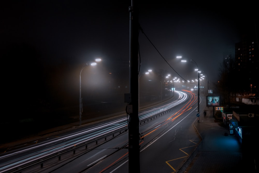 time lapse photography of vehicles travelling on road at night