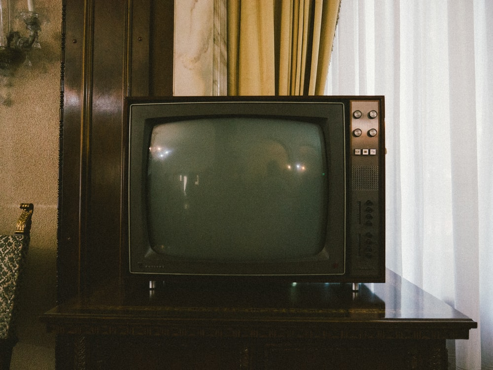 turned-off gray CRT TV on table