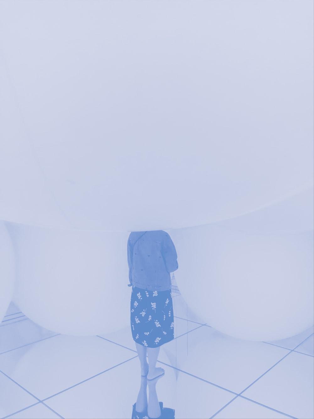 woman standing on tile floor