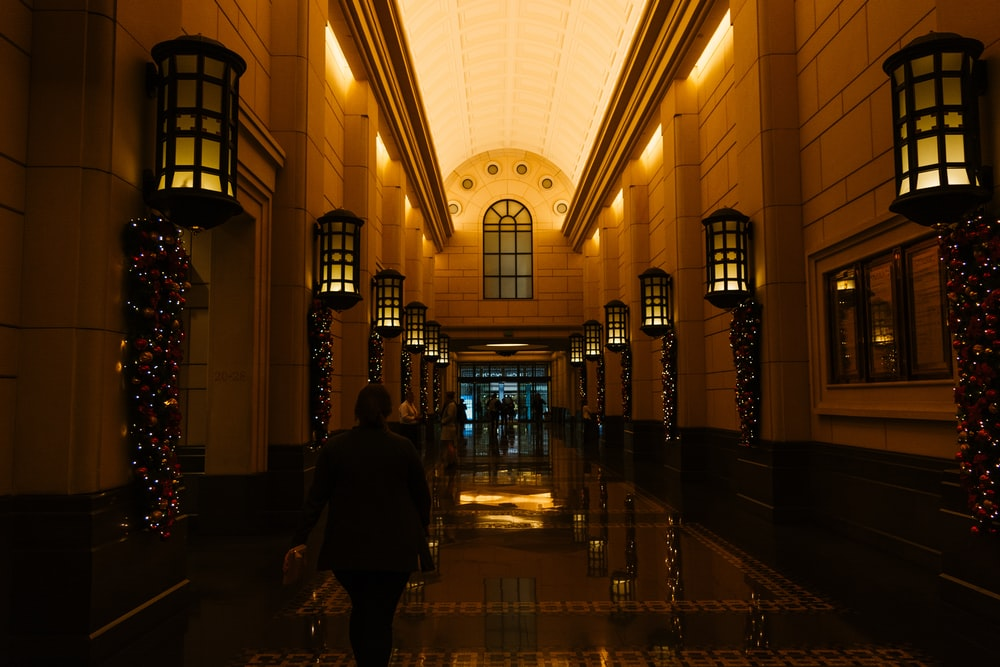 person walking on lighted hallway