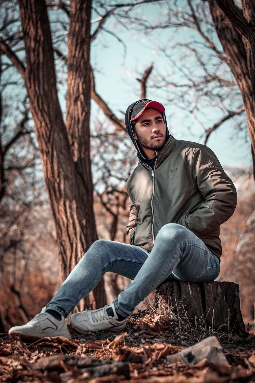 man sitting on cuted tree