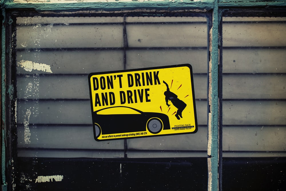 Don't Drink and Drive poster on glass panel