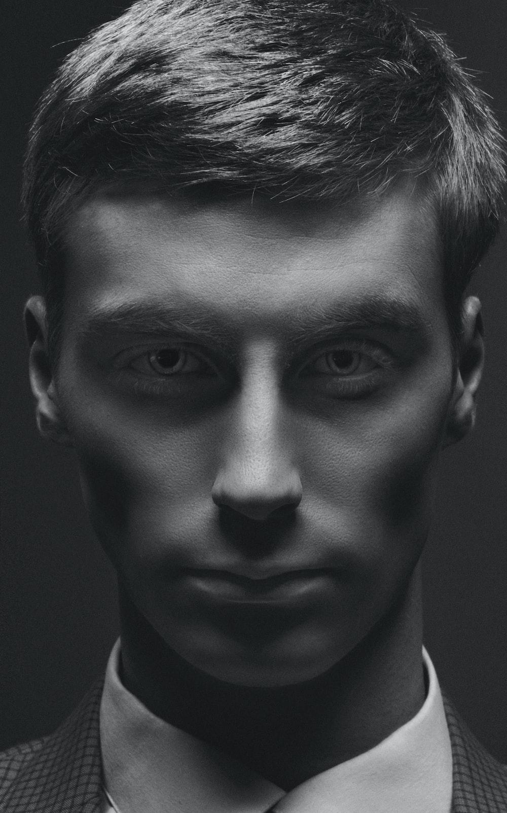 monochrome photo of man's face