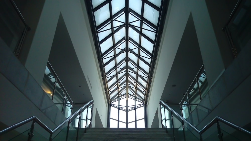 low-angle photograph of building interior with sunroof