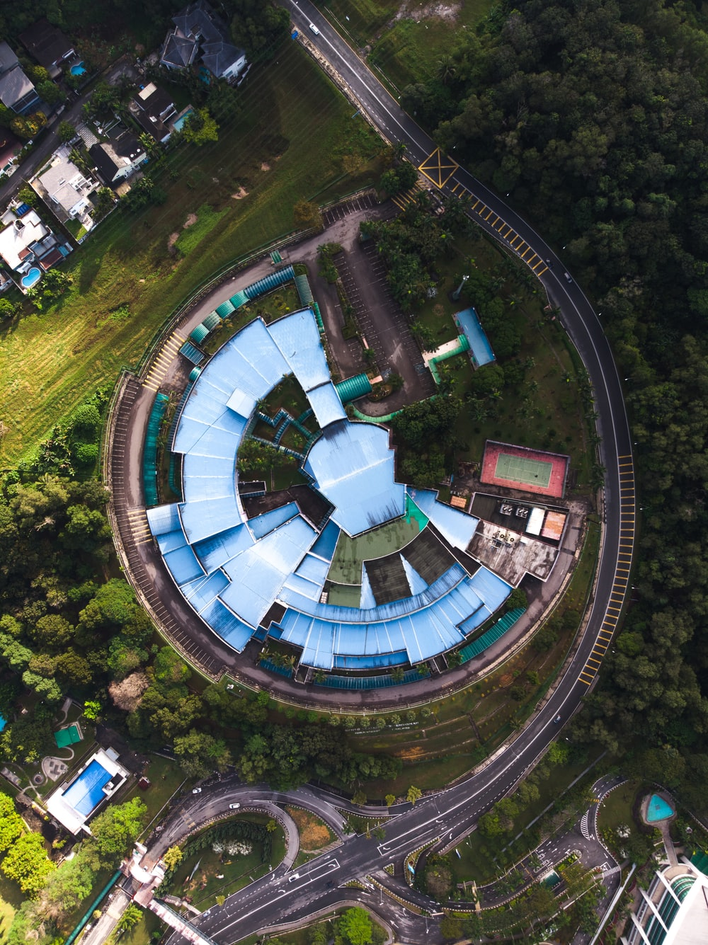 aerial photograph of blue structure on hill