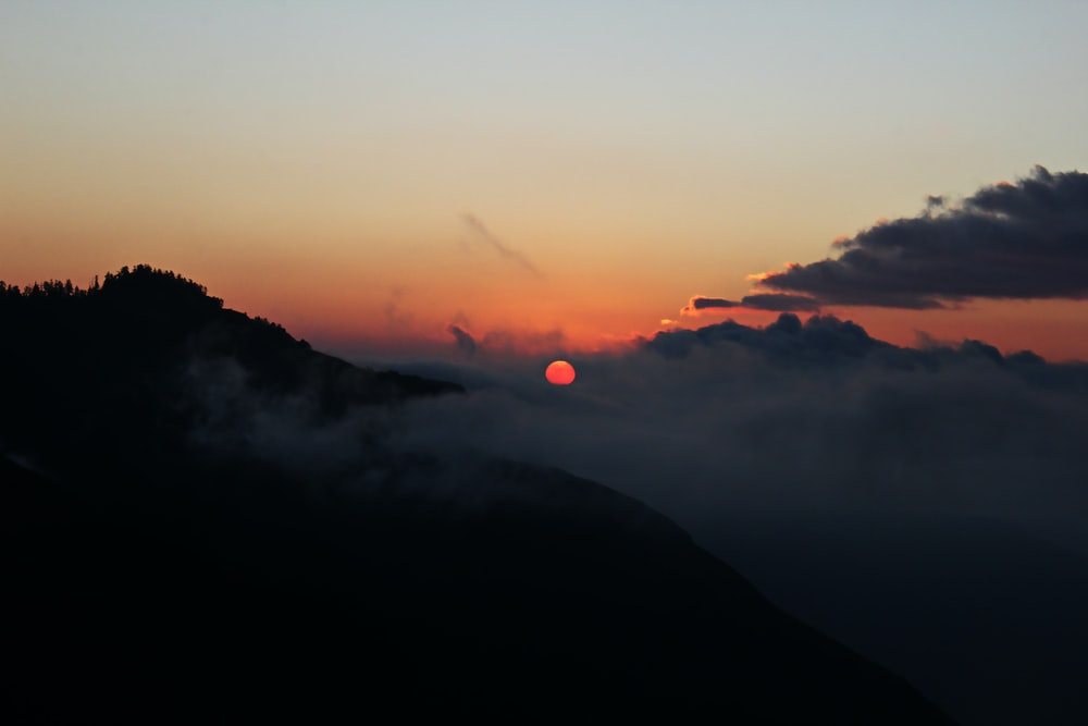 white sea of clouds sunset silhouette mountain scnery