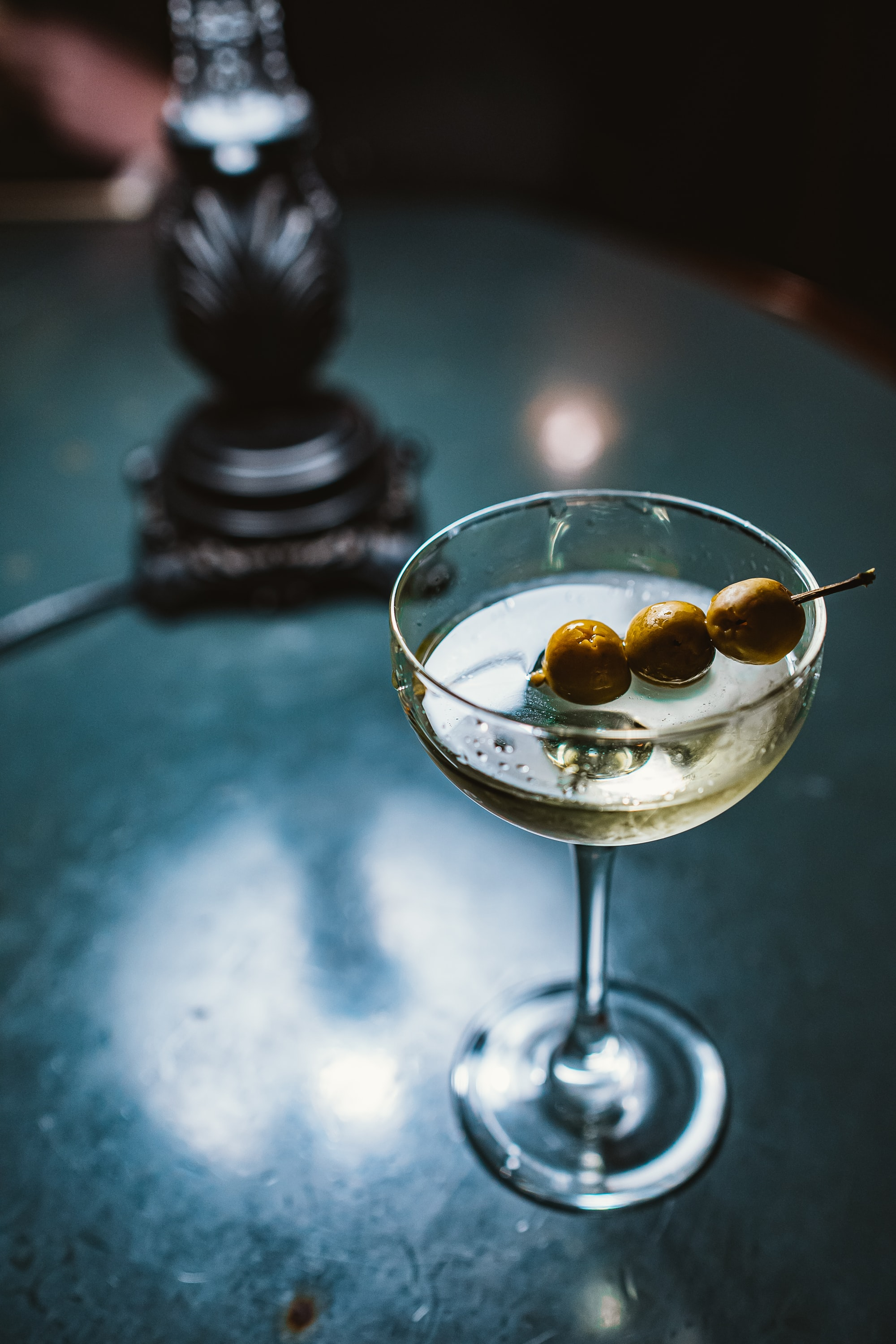 martini cocktail with 3 olives