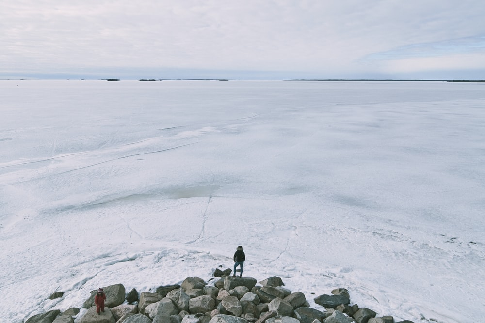 person standing on icy surface