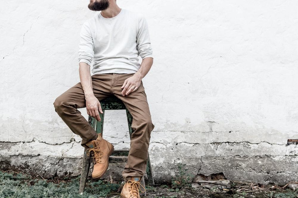 man sitting on stool