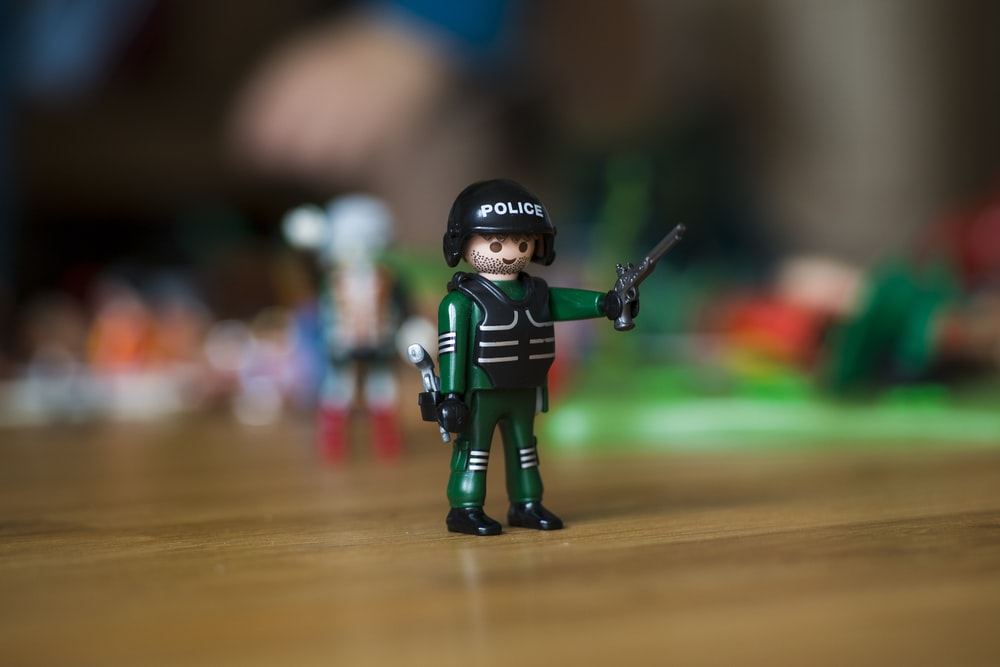 green Police man toy
