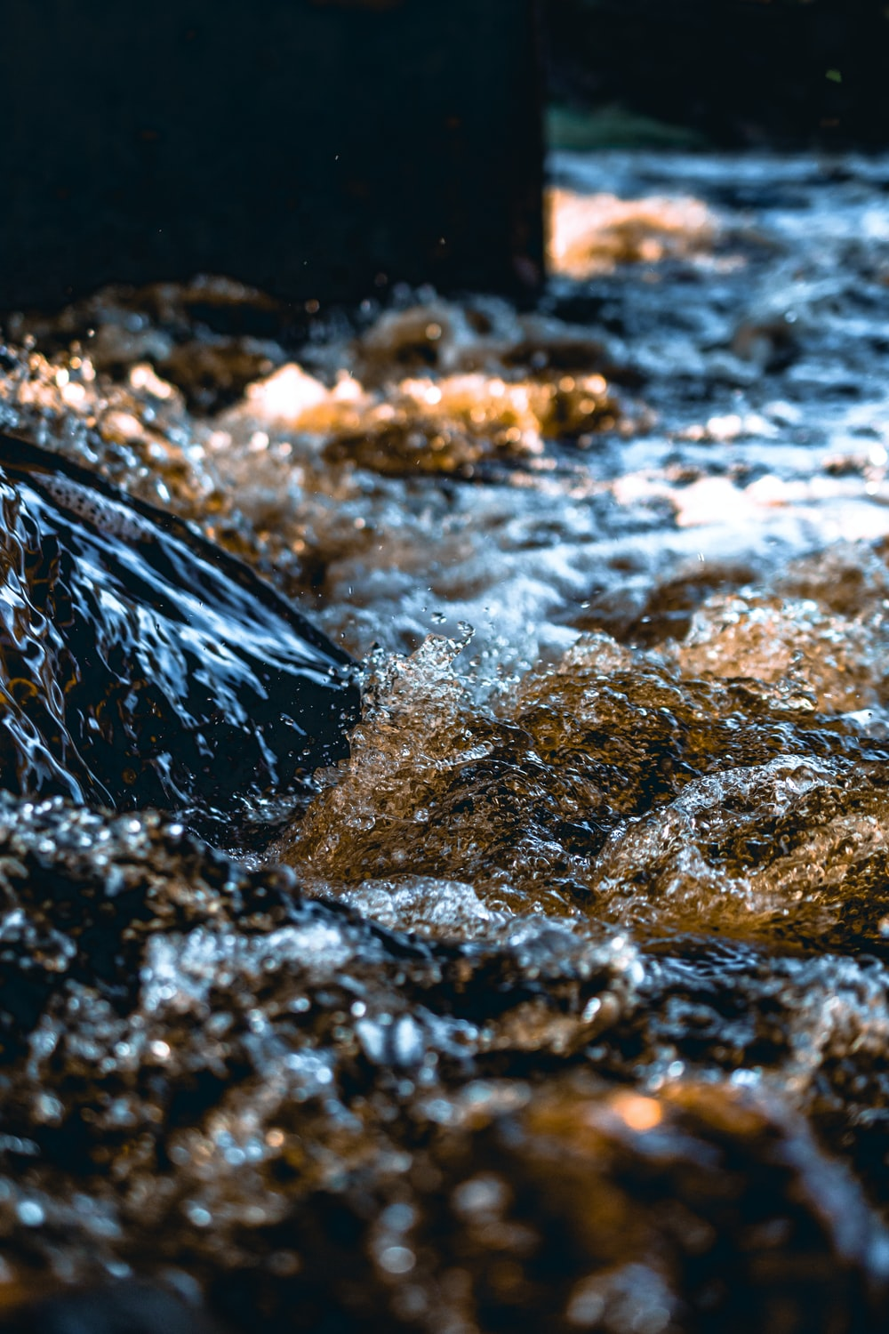 time-lapse photography of water on rocks
