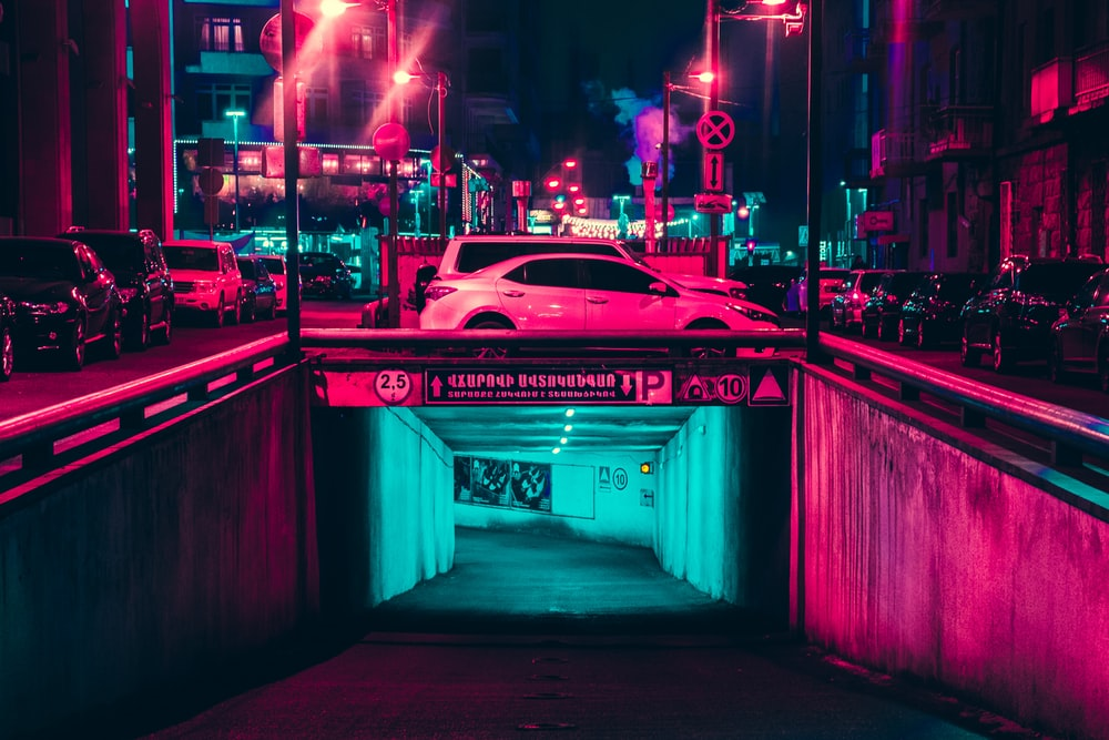 white sedan under of tunnel