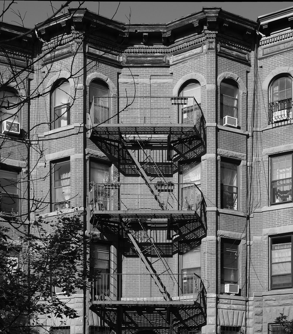 building with fire exit stairs during day