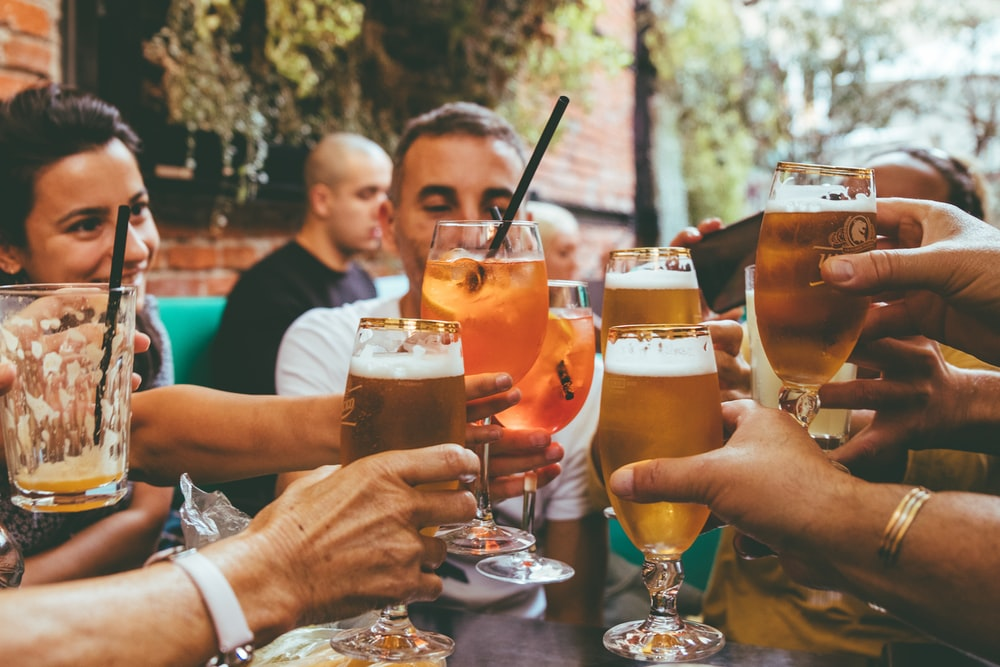 people holding drinks during day