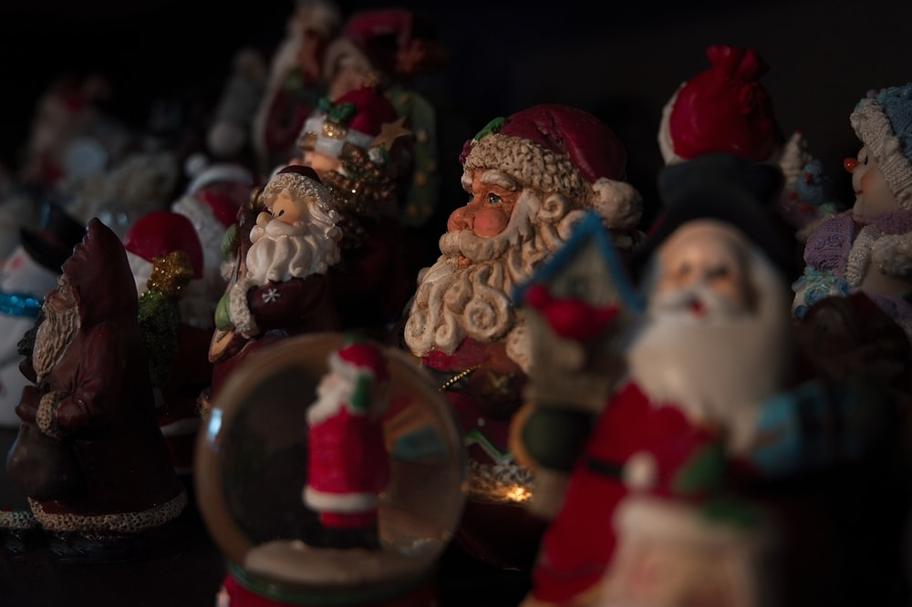selective focus photography of Santa Claus figure lot
