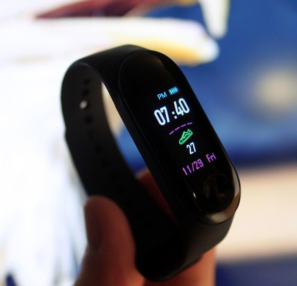 black Xiaomi Mi fitness tracker displaying 07:40