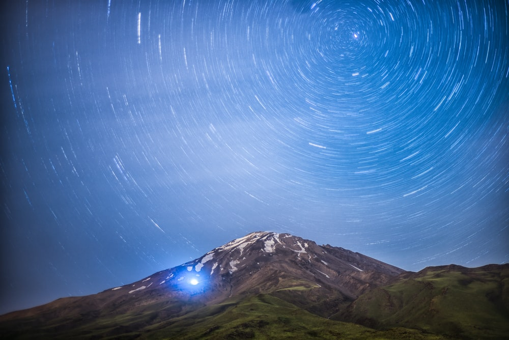 time lapse photo of mountain summit