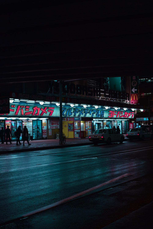 vehicles crossing road at night