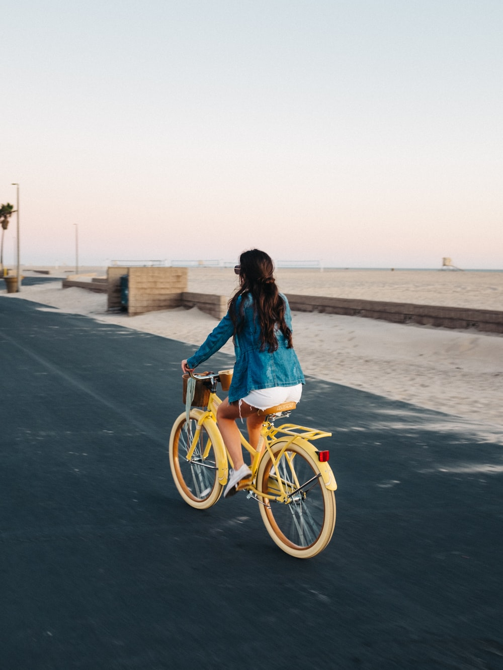 woman riding on yellow bicycle
