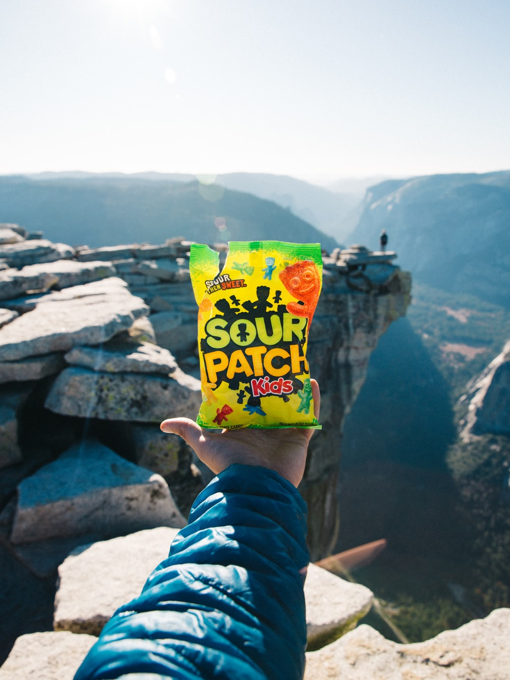 person holding Sour Patch pack