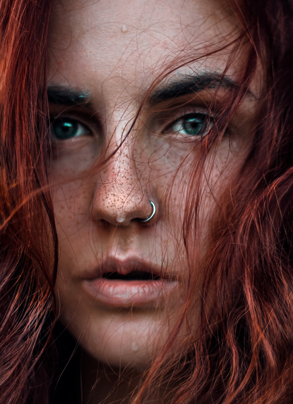 portrait photograph of woman with silver nose ring