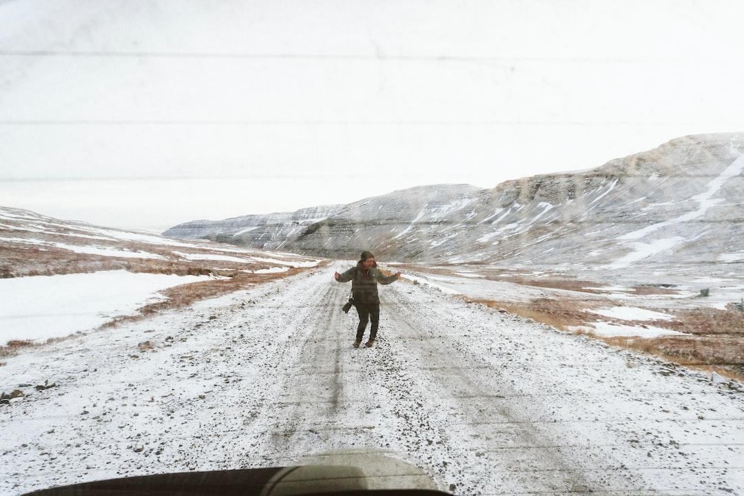 Dancing photographer through a dirty rear car window
