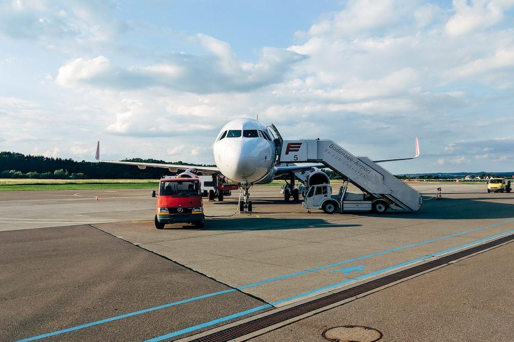 white passenger plane on runway