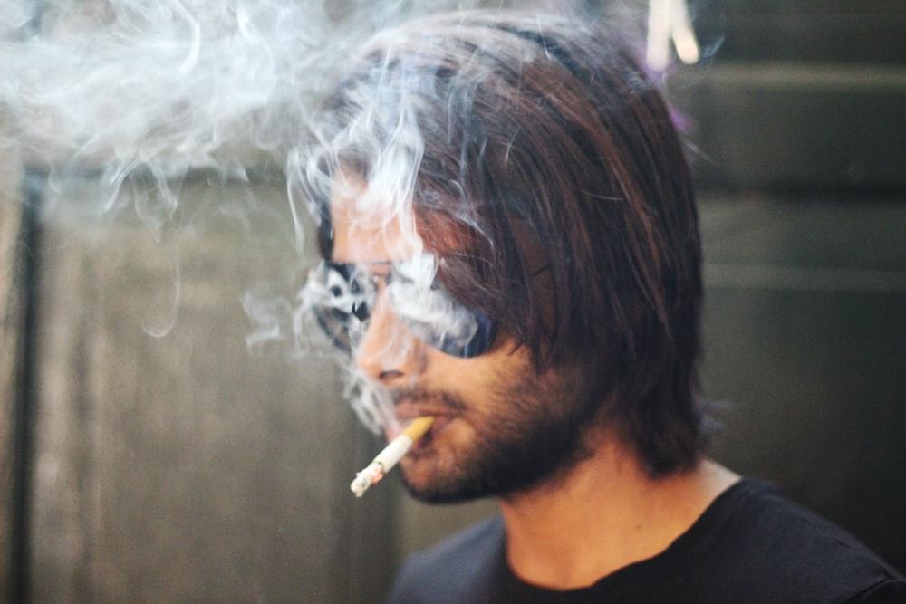 selective focus photography of smoking man
