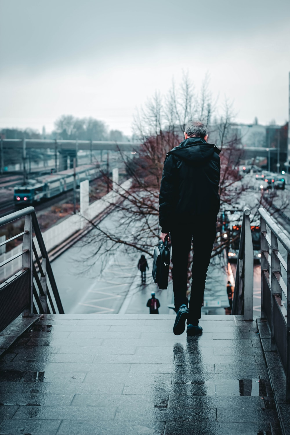 person by concrete stairs during foggy weather