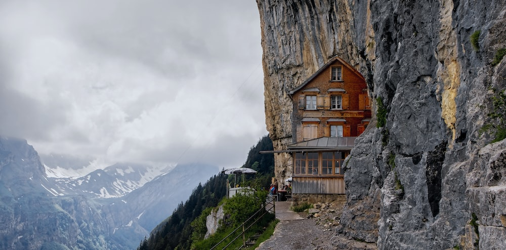house beside cliff
