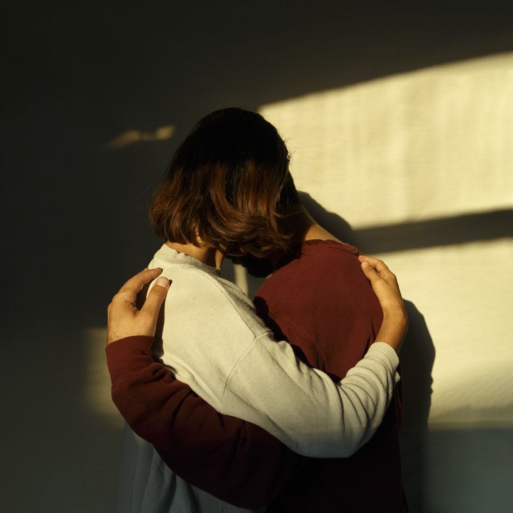 man and woman hugging each other
