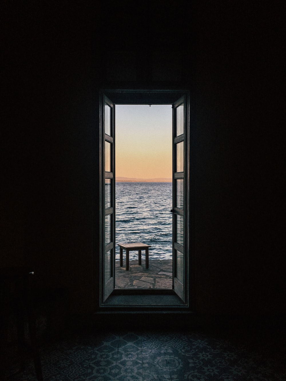 table near body of water