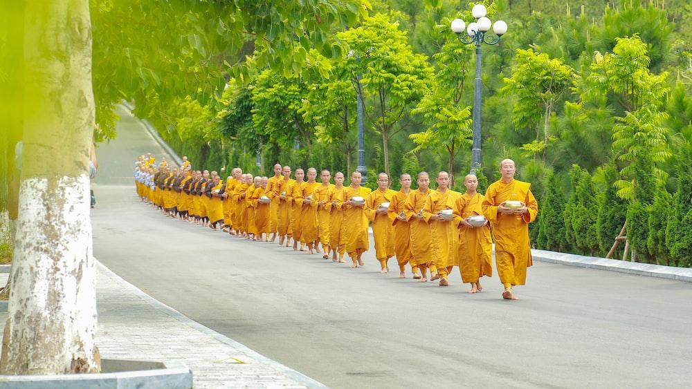 monks walking on road
