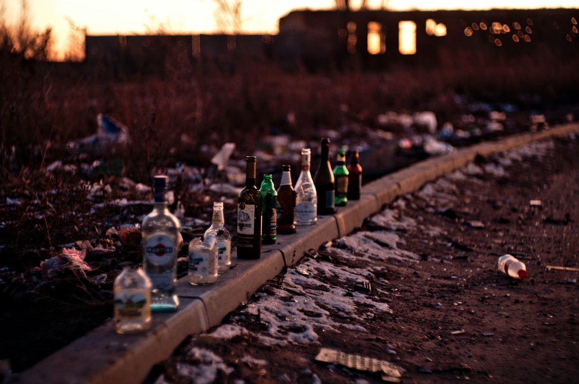bottles on brown concrete surface