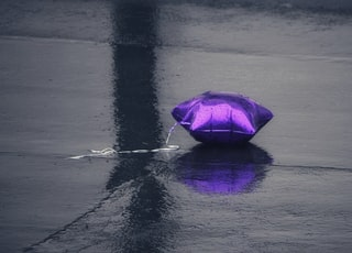 purple balloon on black floor
