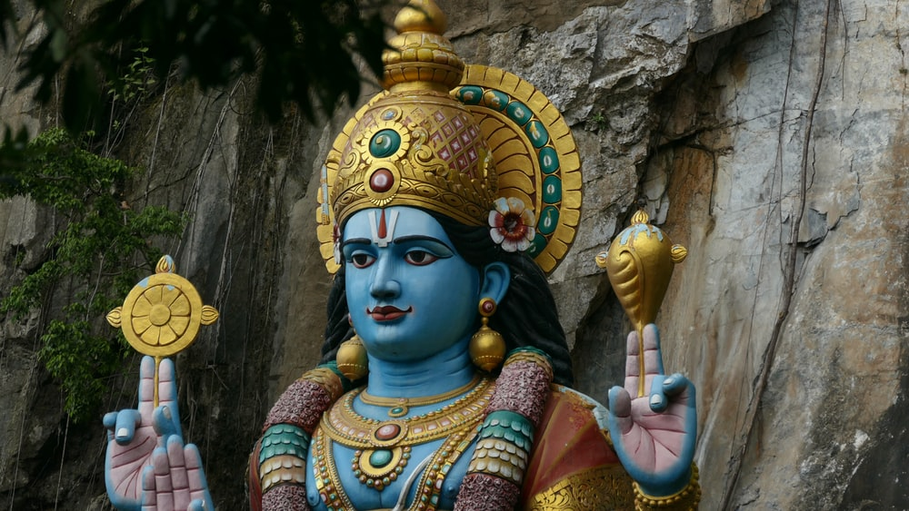 blue and gold deity statue