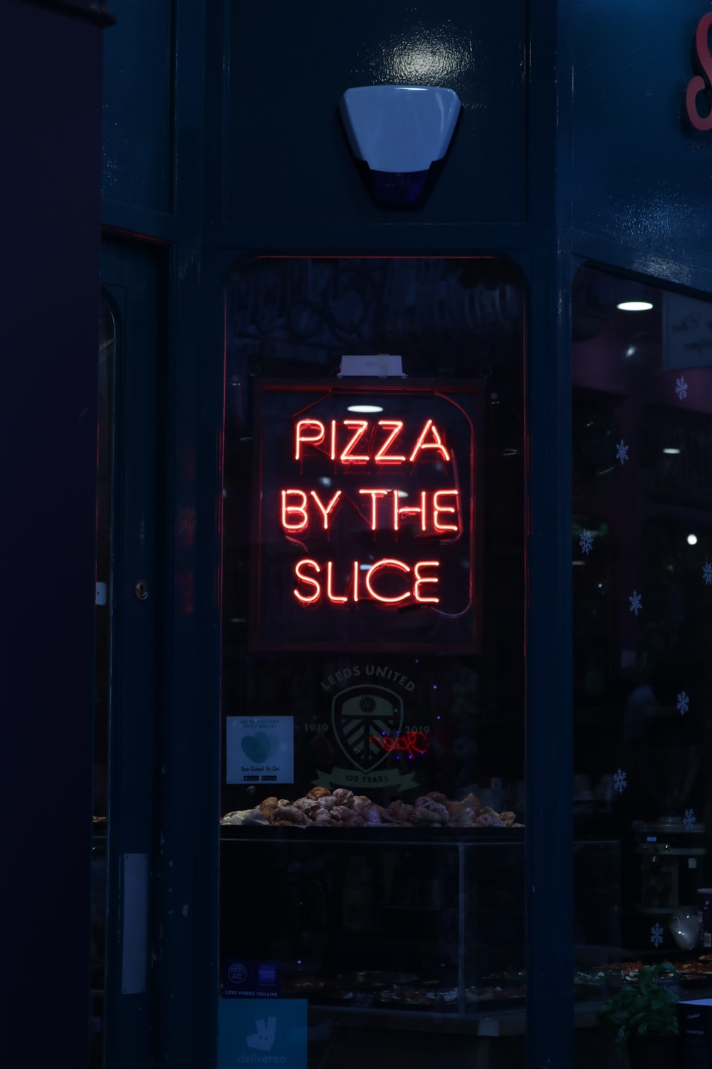 Pizza By the Slice neon signage