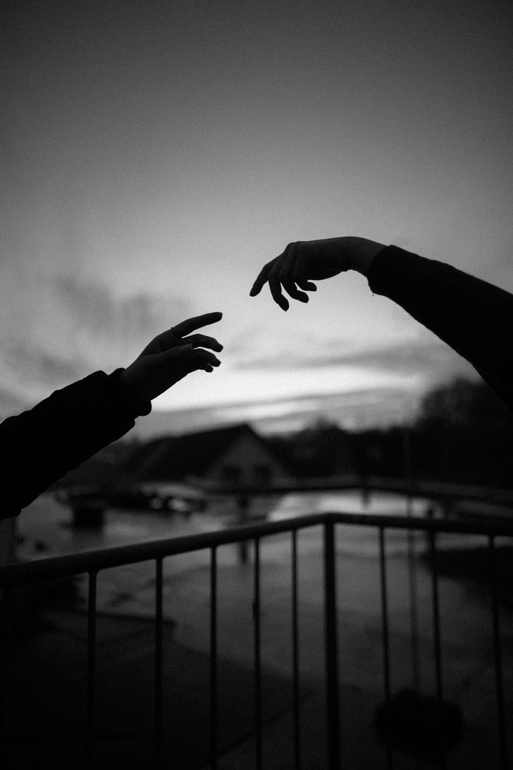 grayscale photo of hands