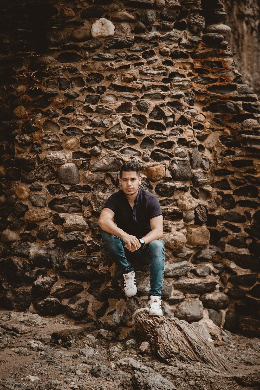 man sitting on stone