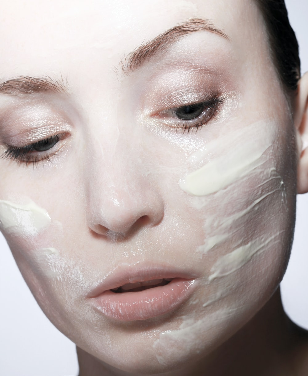 woman with face cream on face