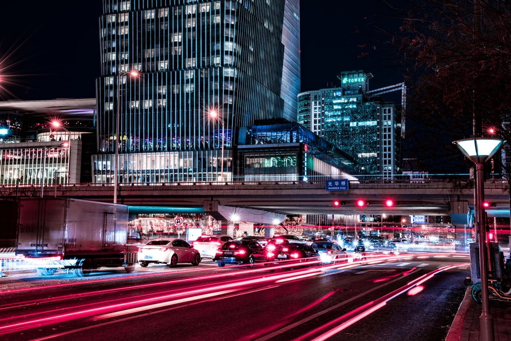 time lapse photography of vehicles passing by city streets during nighttime