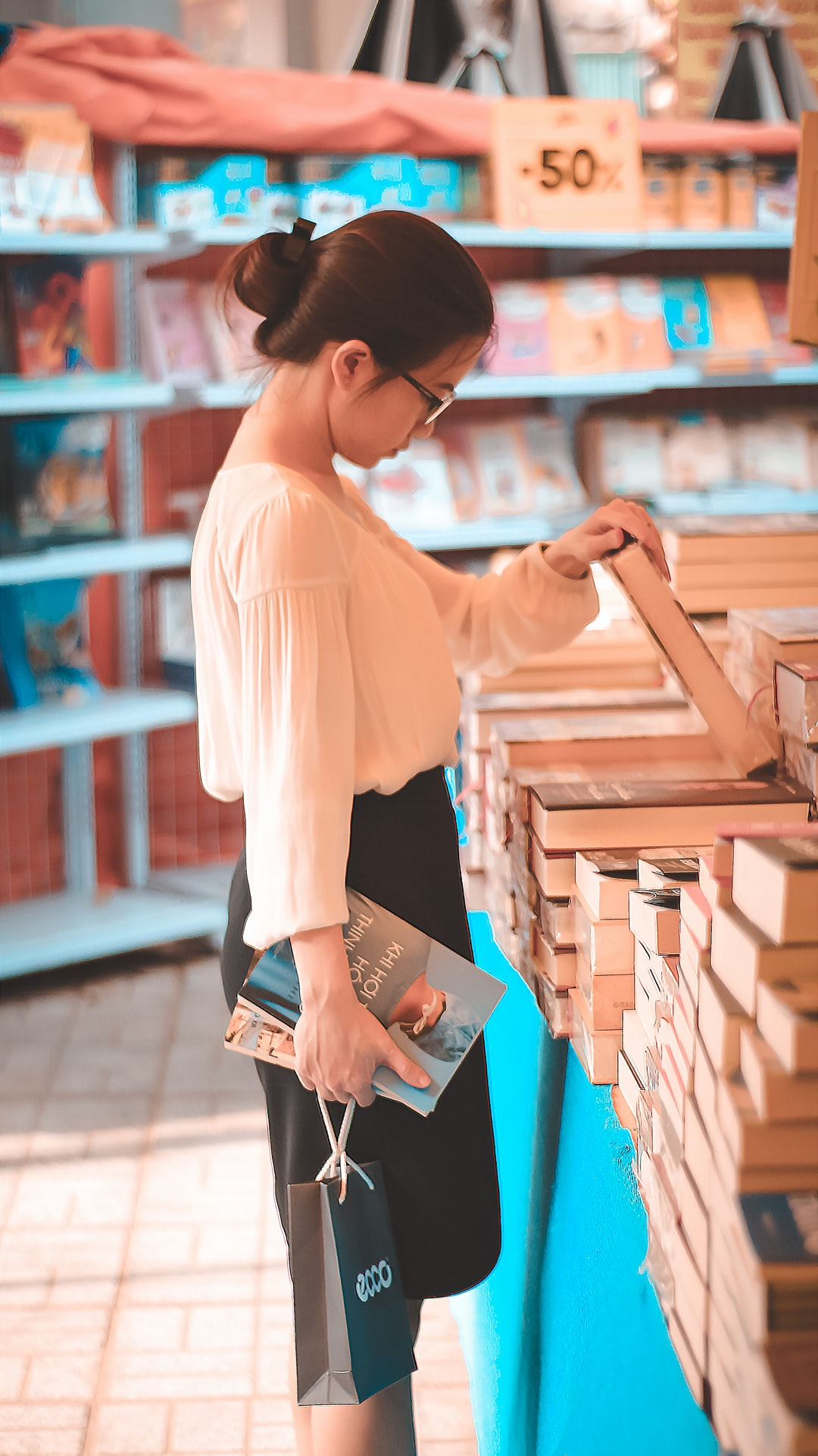 girl watching book