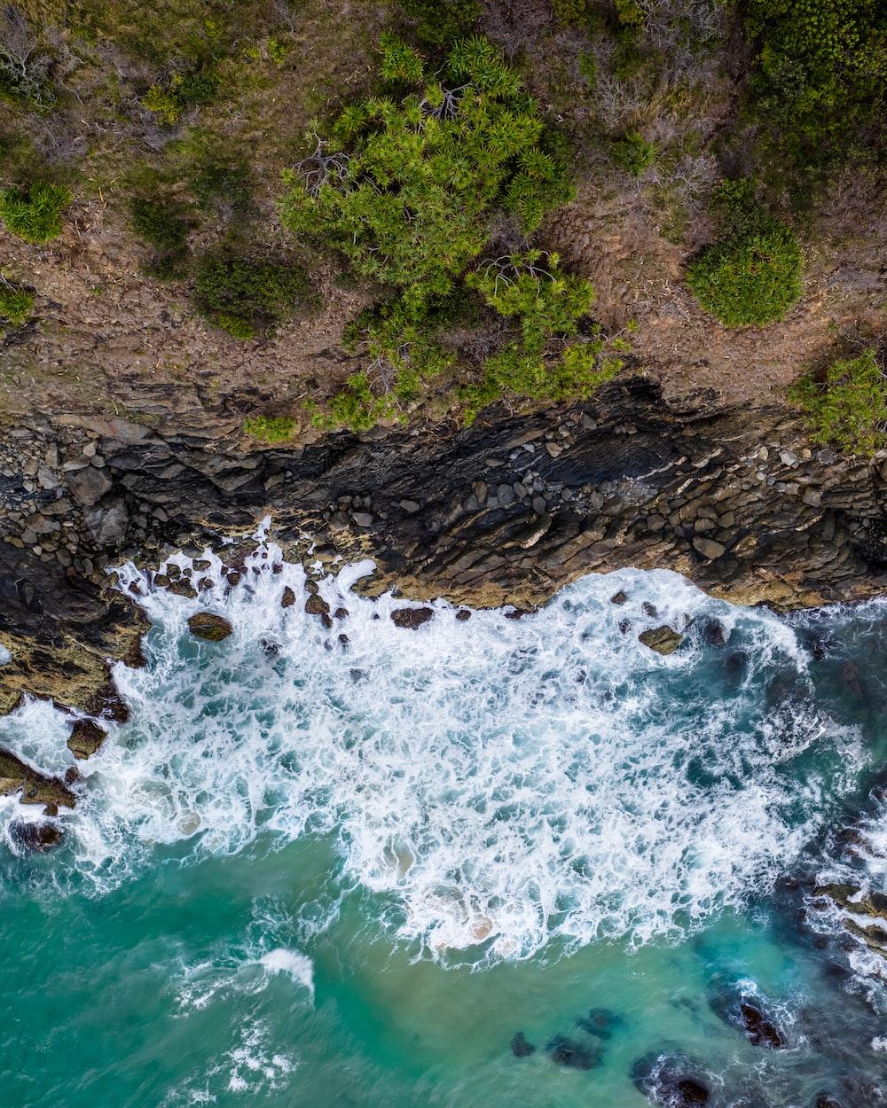 sea waves crashing on stone