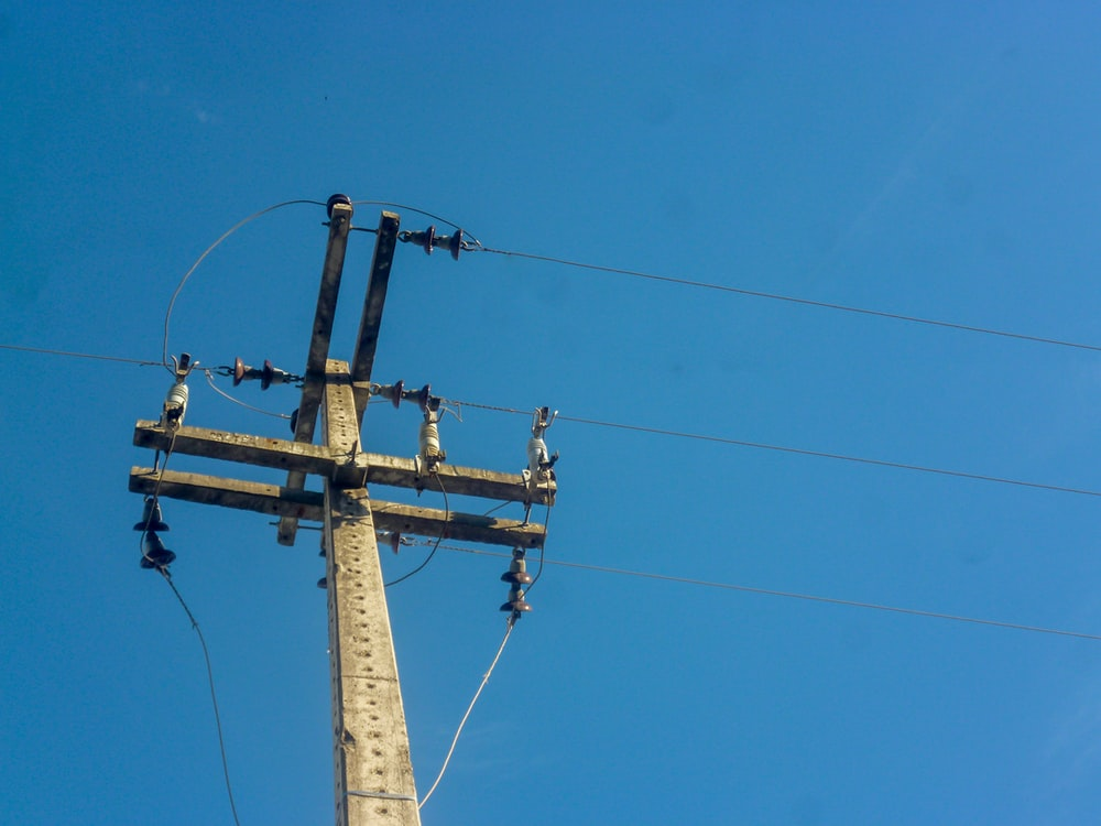 brown and black utility electric post