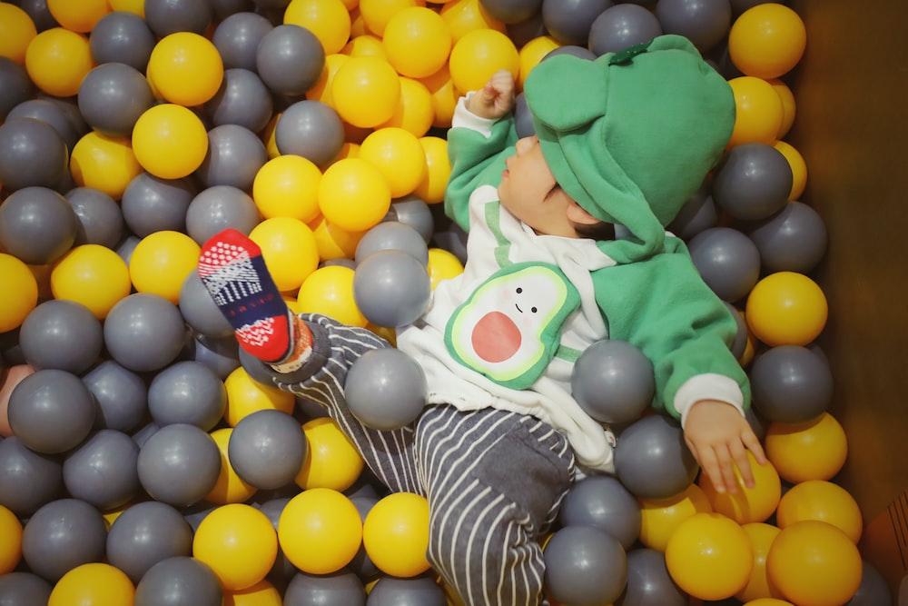 toddler playing balls