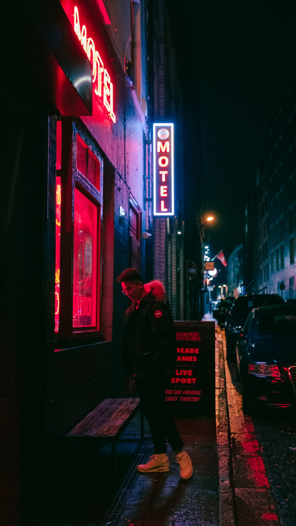 man standing beside motel